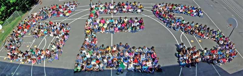 Aerial photo of GES students spelling out G...E...S.